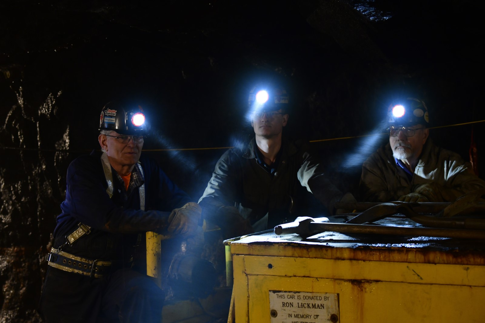 Miners with helmet lights