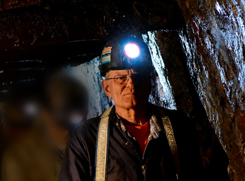 Miner with helmet light